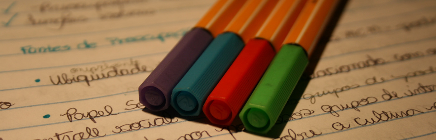 Coloured pens on open notebook